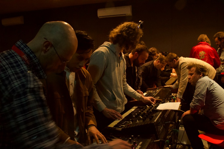 crowding around synths